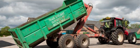 Tractor dropping off Skip
